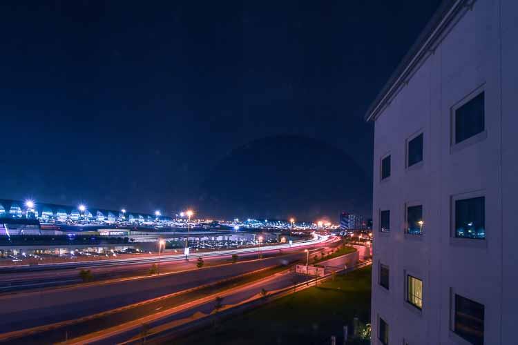 View of Dubai Airport Terminal 3 at night from Premier Inn Dubai International Airport hotel