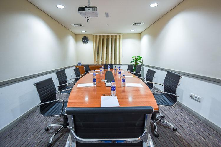 Meeting room set up for a business meeting at Premier Inn Dubai International Airport hotel