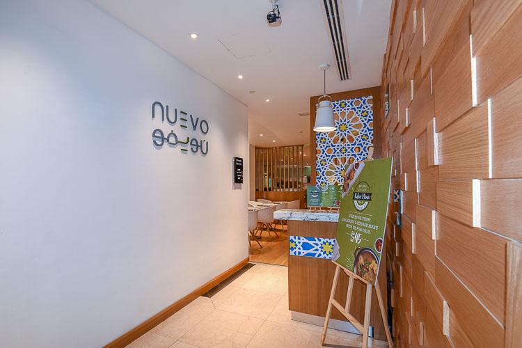 Entrance to Nuevo all day dining restaurant at Premier Inn Dubai International Airport hotel
