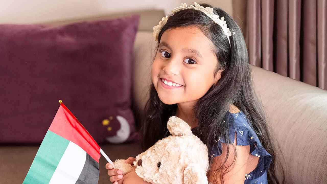 image of a girl holding emirates flag at premier inn dip
