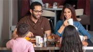 image of a family having breakfast at dubai investments park hotel