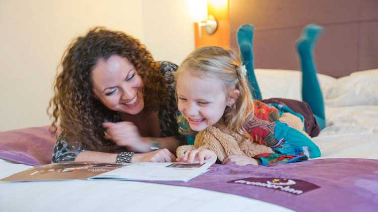image of a mom and a daughter in premier inn hotel