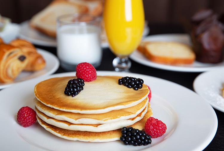 Breakfast pancakes in hotel restaurant near Doha Airport