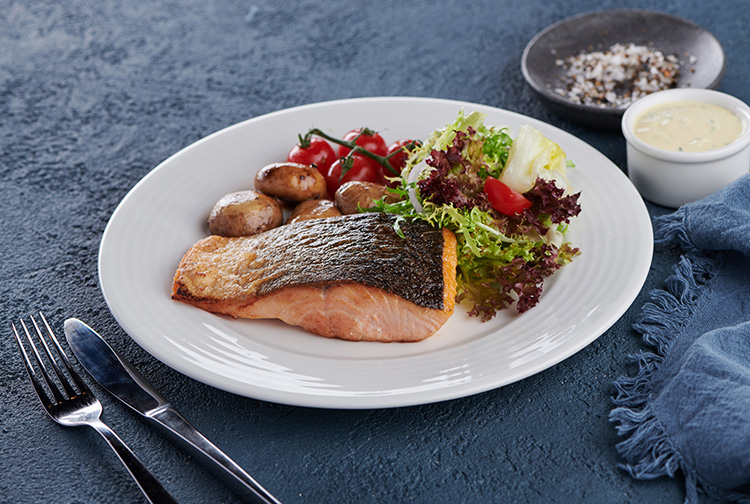 Salmon with fresh salad at restaurant in Premier Inn hotel in Dubai
