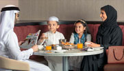 image of family having lunch at premier inn doha hotel