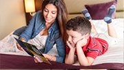 image of mother reading bed time stories for her kid at premier inn hotel