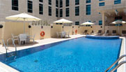 image of roof top swimming pool doha hotel