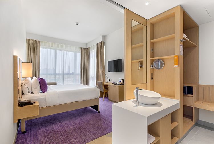 Spacious bedroom with ensuite bathroom in a budget hotel in Dubai