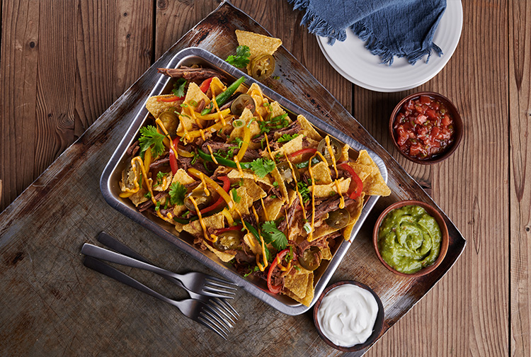 Lunch plate with nachos and sauces served in restaurant pub in hotel in Dubai Silicon Oasis